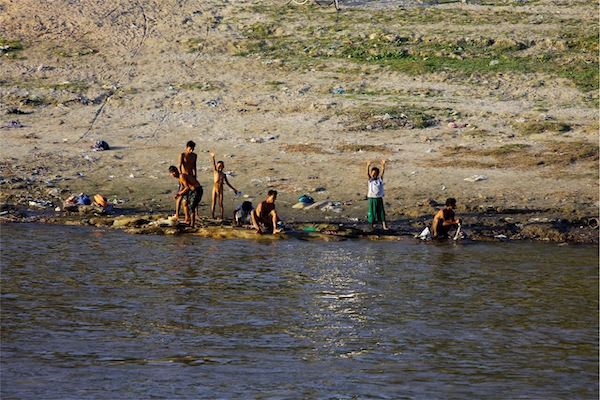 Irrawaddy Explorer's 10-Day Treasure of Golden Myanmar Downriver - Day Three - Local Kids Washing by The River