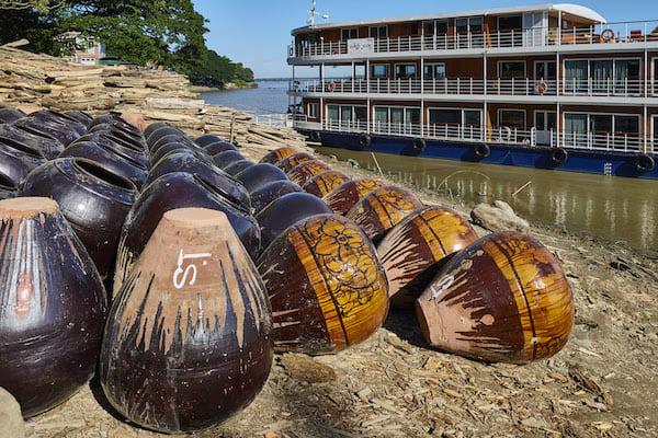 Paukan Princess' 11-Day Burmese Days Upriver - Day Stoneware by River Bank