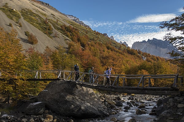 Tierra Patagonia's 7-Day All Inclusive Program Day Four - Hiking over a bridge.
