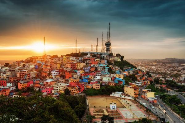Kontiki's 8-Day Toquilla Expedition Itinerary Day Eight - Ecuadorian Sunset over city.