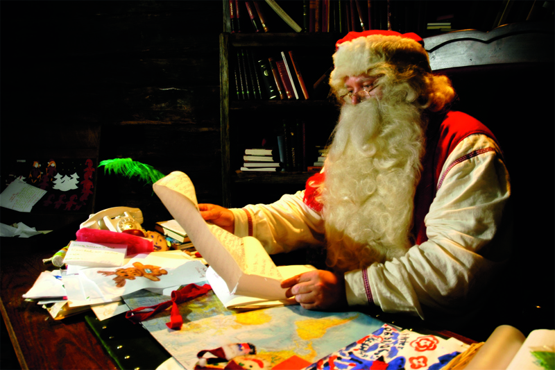 santa reading letters he has received