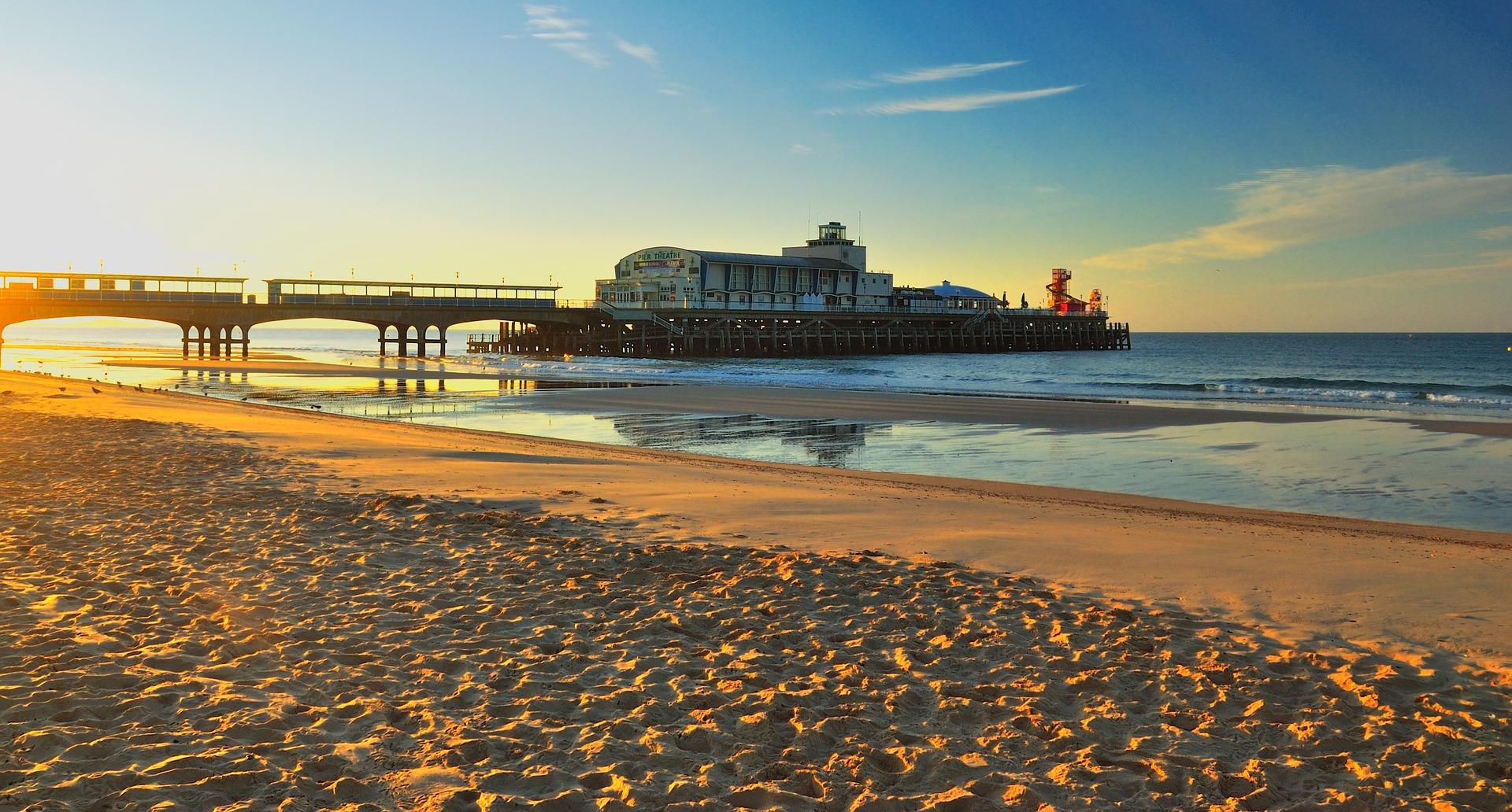 Sandy beach and pier