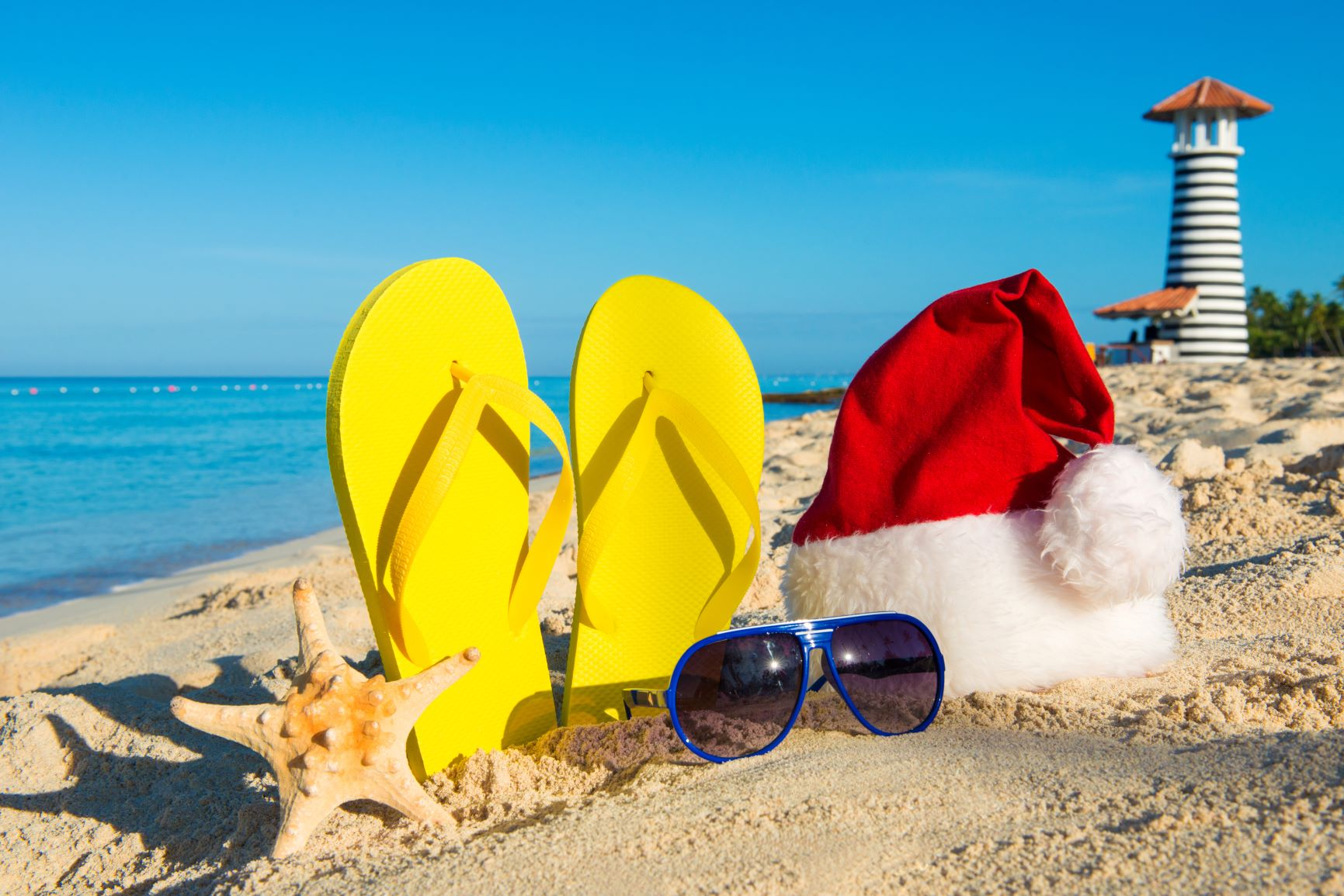 Santa hat and flip flops on the beach