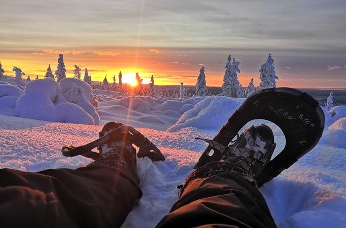 Snowshoeing at sunset