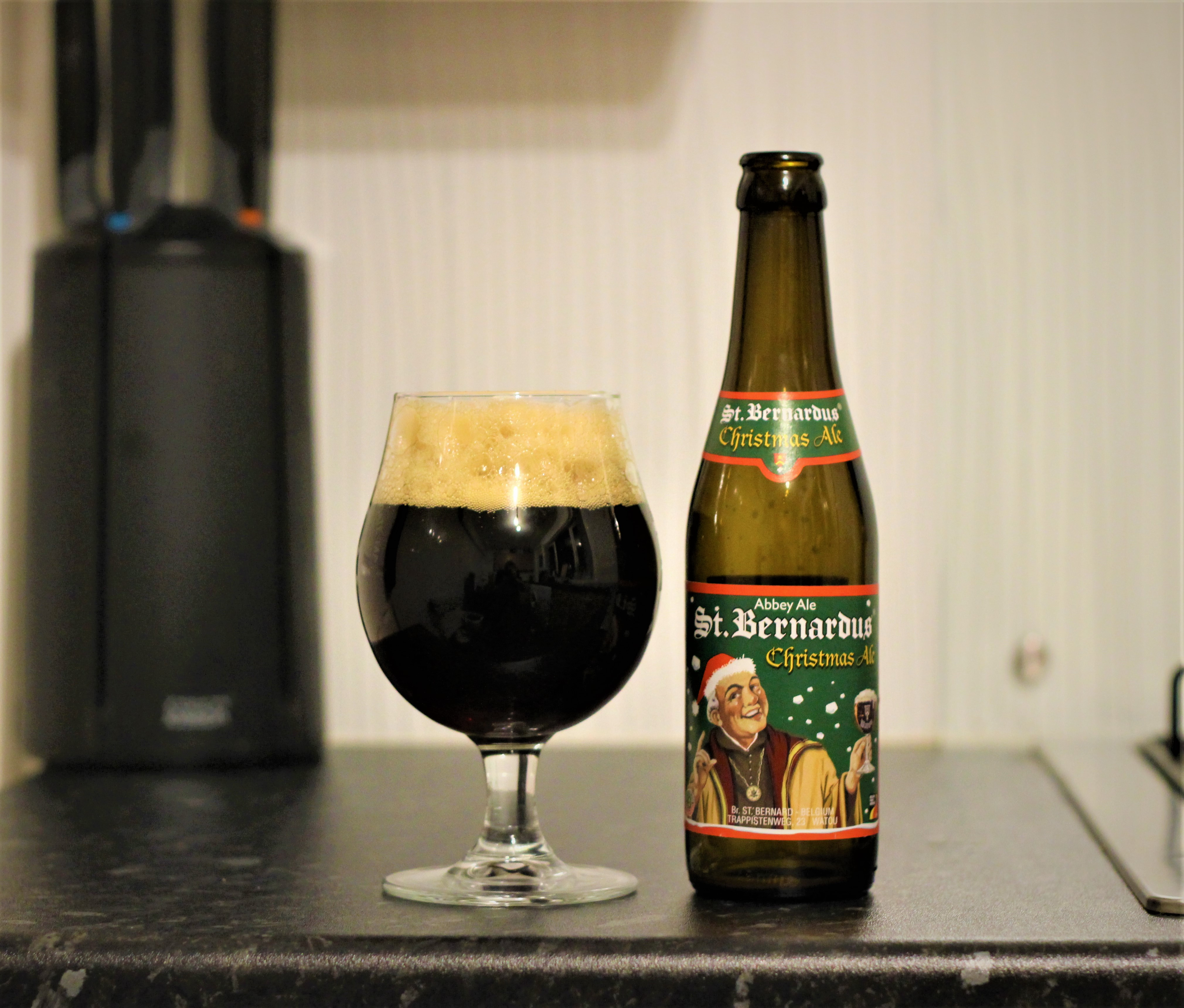 photo of st bernardus beer in a glass next to the bottle