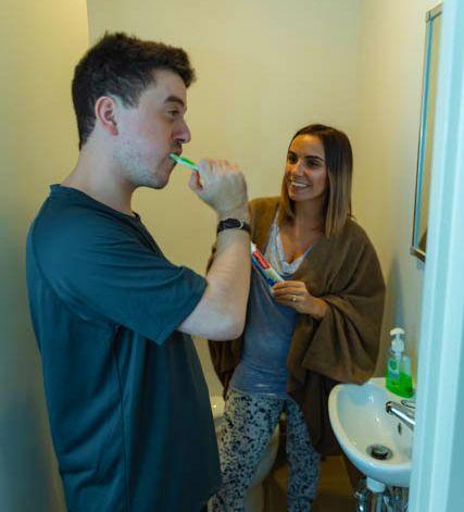 NDIS Participant brushing teeth