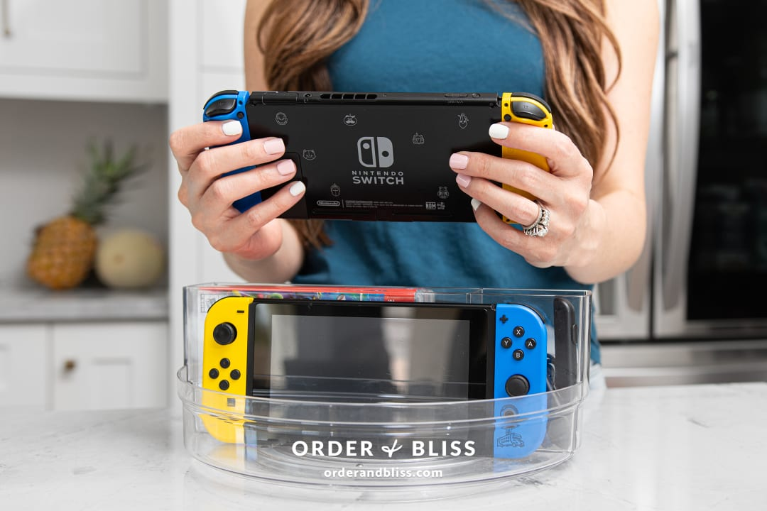 Spin the Console! This Clear Turntable Stores a Nintendo Switch, Joy-Con Controllers, Video Games, and More