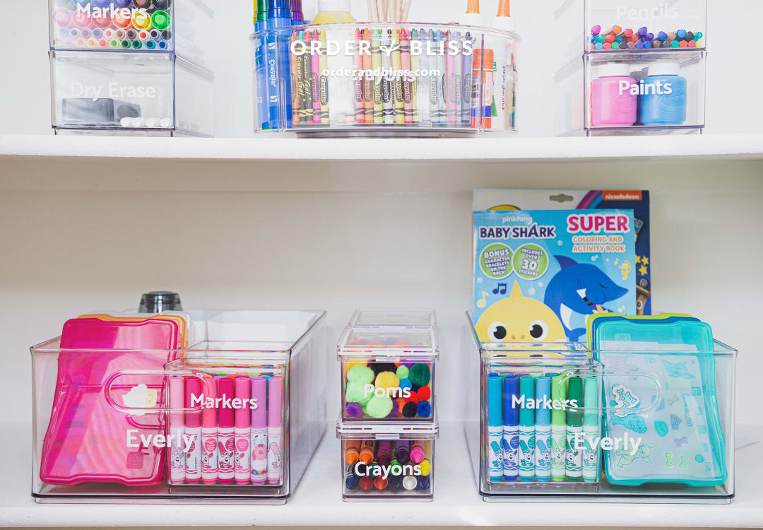 Clear organizing containers with markers and crayons