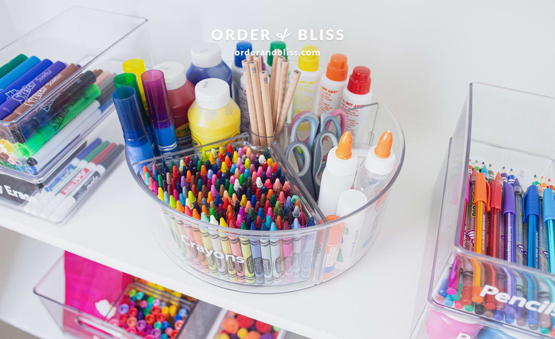 Organizing turntable with crayons, glue, and do-a-dots