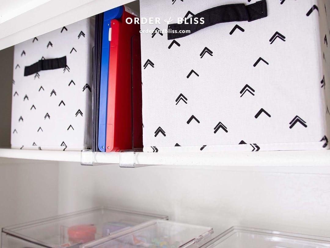 Vertical board game organization using tall shelf dividers