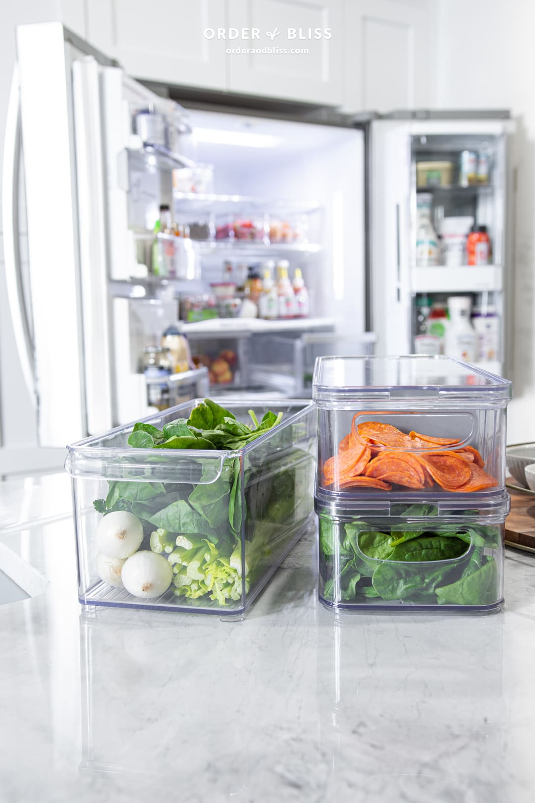 Organized fridge with home edit clear containers