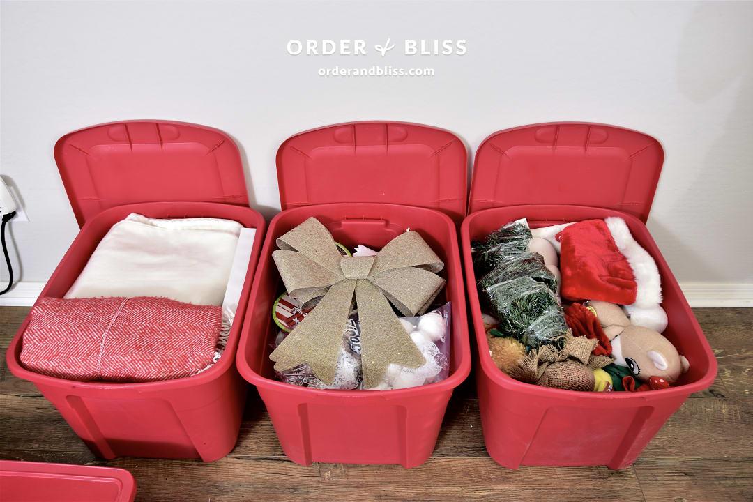Sterilite storage bins with organized Christmas decor and ornaments