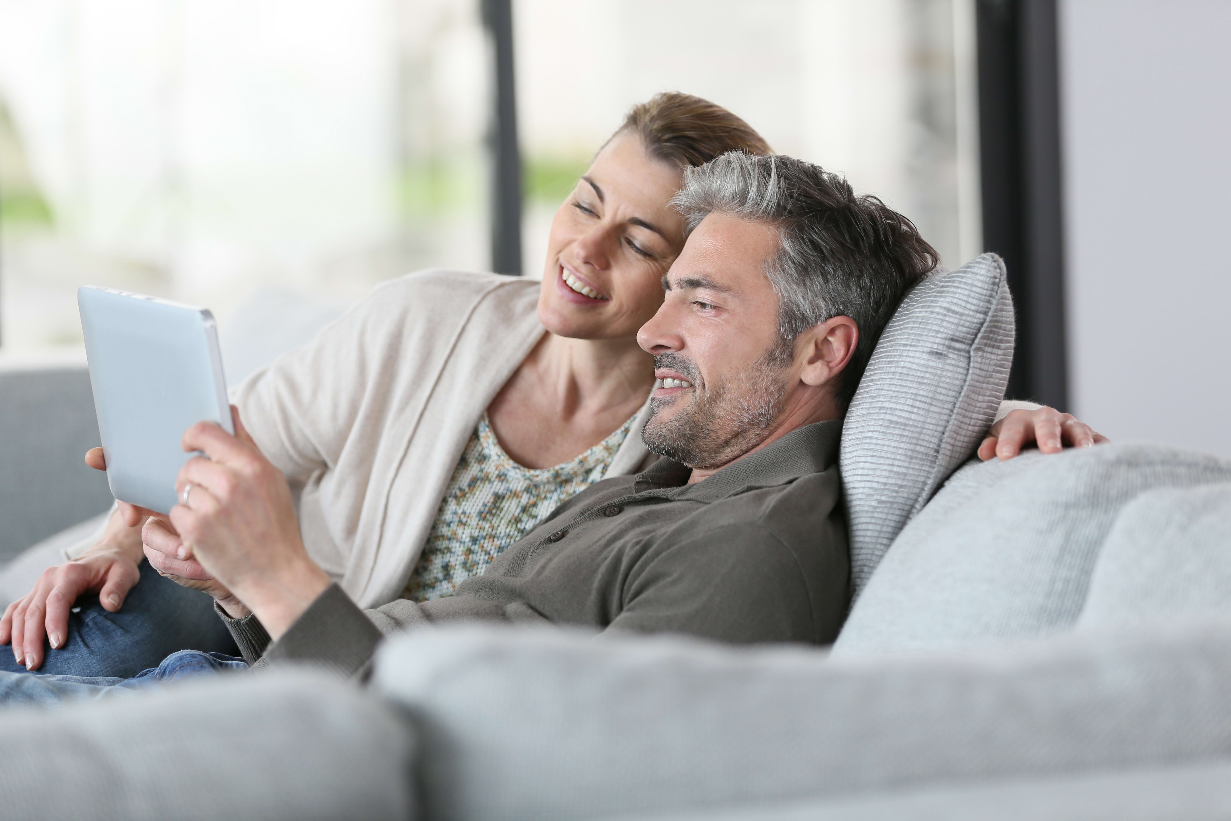 Image of a couple looking at a tablet