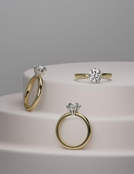 Podeum displaying three engagement rings