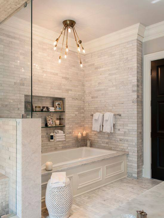 homebunch.com  stylish marble tiles on the floorings, walls, and shower bring a unified aim to this stylish area. The gleaming white marble is specifically helpful in bathrooms