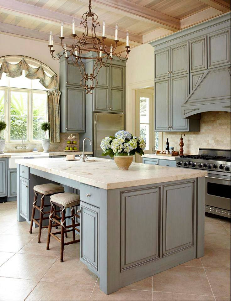 Another light blue one more detail & The island top looks like sandstone love the  kitchen Island bar-chairs