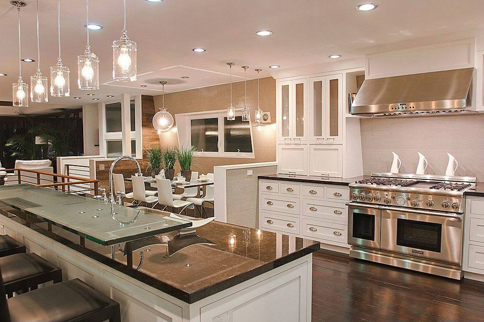 Luxurious kitchen with lots of stainless steel and 2 tier lever kitchen island