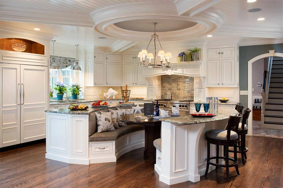 The kitchens with Island should  definitely provide a seating solution. I am stunned by the ceiling work as well. love the  kitchen Island bar-chairs