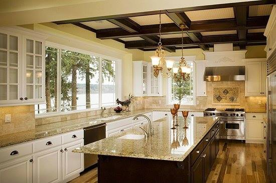 Great kitchen Island in cherry with garnit top Note the under mount sink and short overhang on the Island
