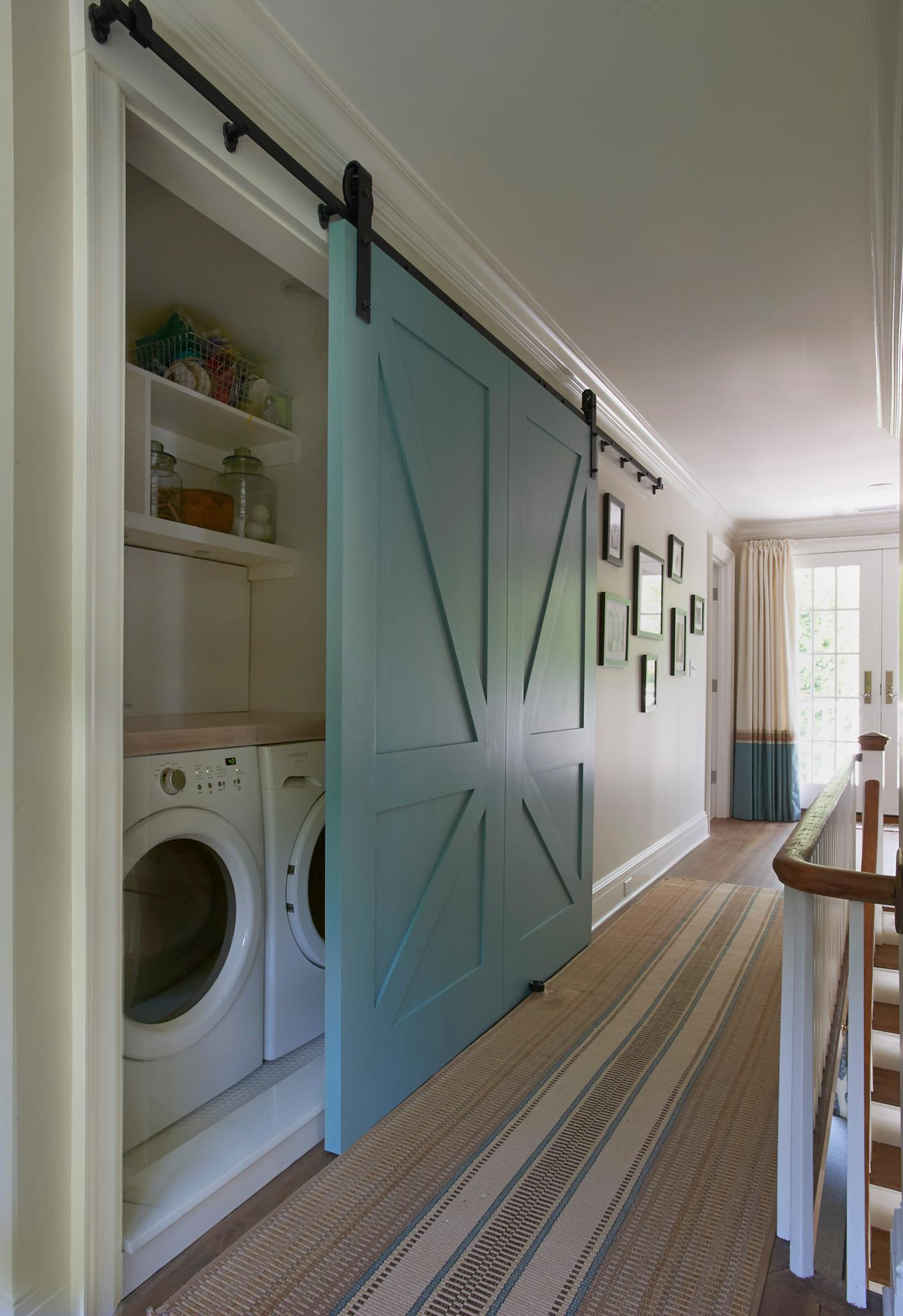 Great Space saving solution and I love the barn door,  Just to bad that there is no room for a stylish farmhouse laundry room sink