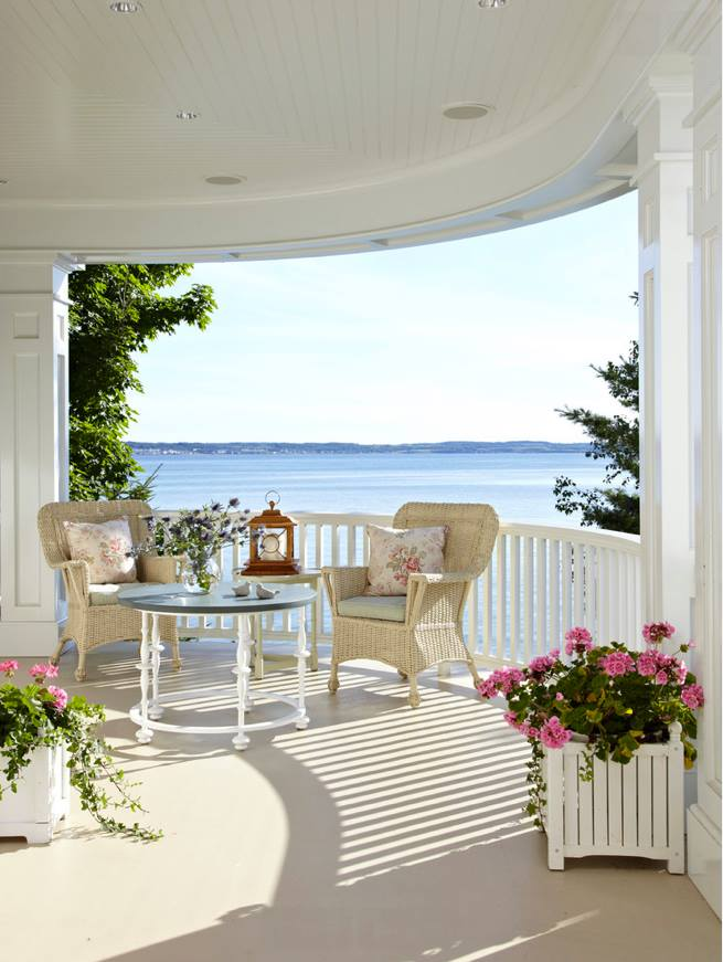 South Beach, cushy and rich looking wicker Patio furniture with large rounded arms and pillows bottom and back to sink down and relax i