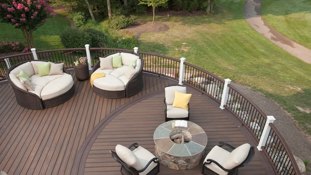 deck construction - composite_deck_with_fireplace_and_mixed_material_composite_railing