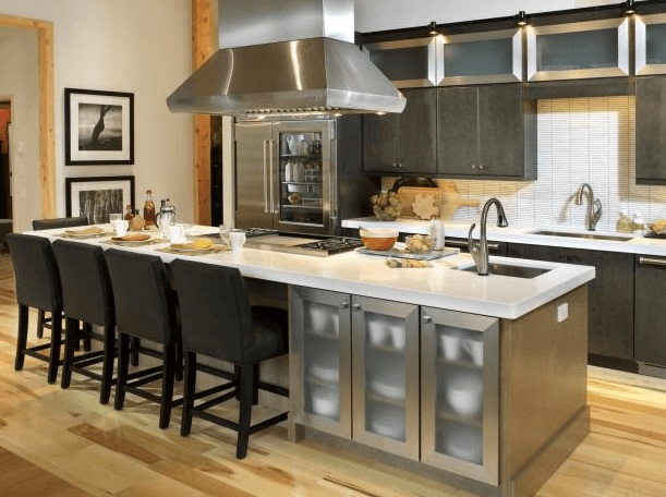 Here the space above the modern kitchen was designed to drop the Range hood over the cooking island.  Modern design I love the  kitchen Island bar-chairs