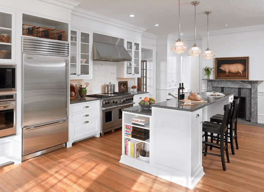 2 level Kitchen Island design with white cabinetry toped by dark gray or black granite top