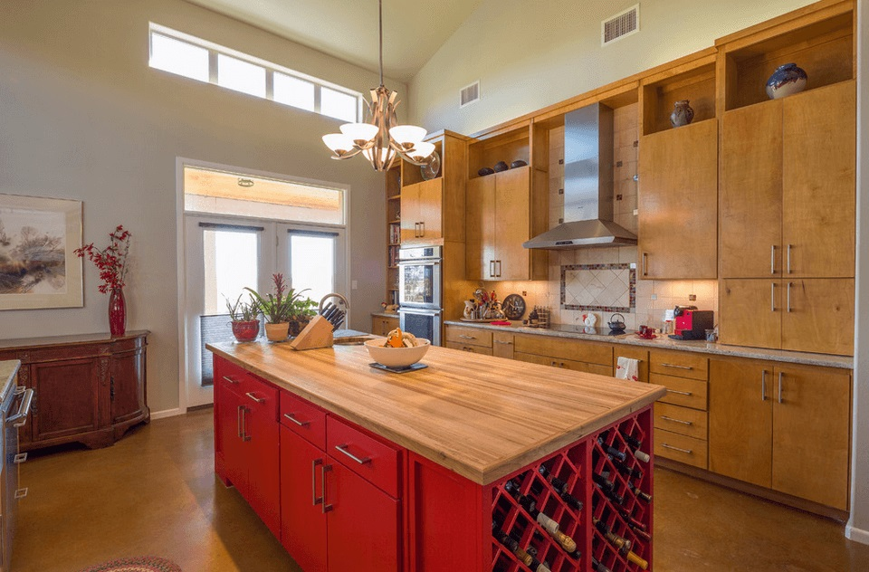 To round up the colors here is a red finish with butcher block top a drop in sink on the back end and a wine rack on the other - genius kitchen island design idea