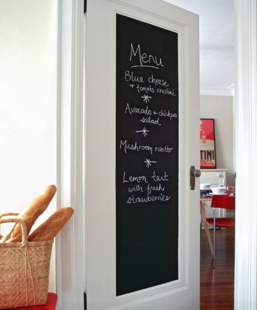 The cabinet door chalk board here is the menu of the day. It could be just as well a NOTE pad or the grocery list