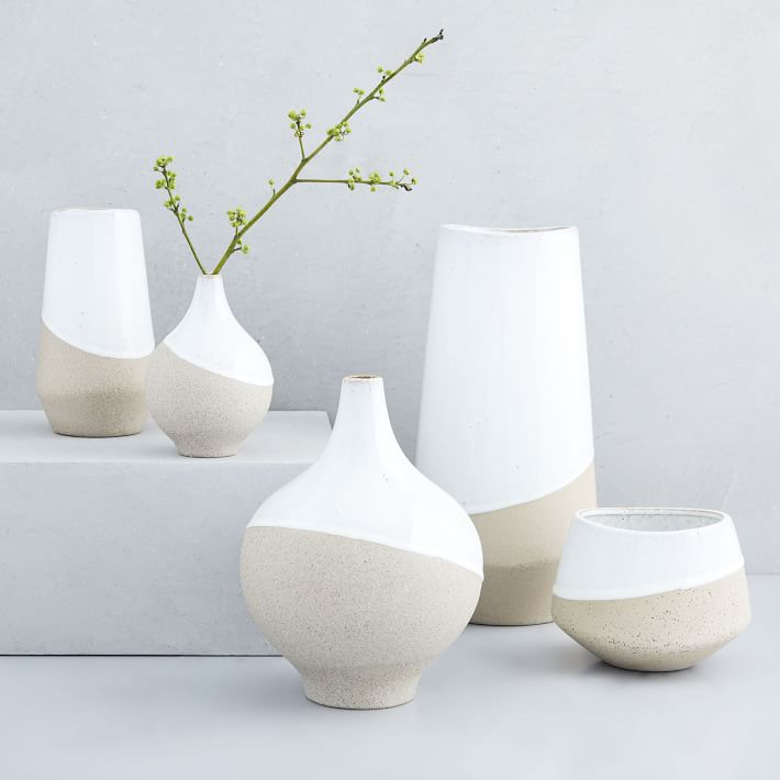 Half-Dipped Stoneware Vases bring together raw, textured stoneware with a glossy, hand-dipped glaze for a rustic mix of matte and shine
