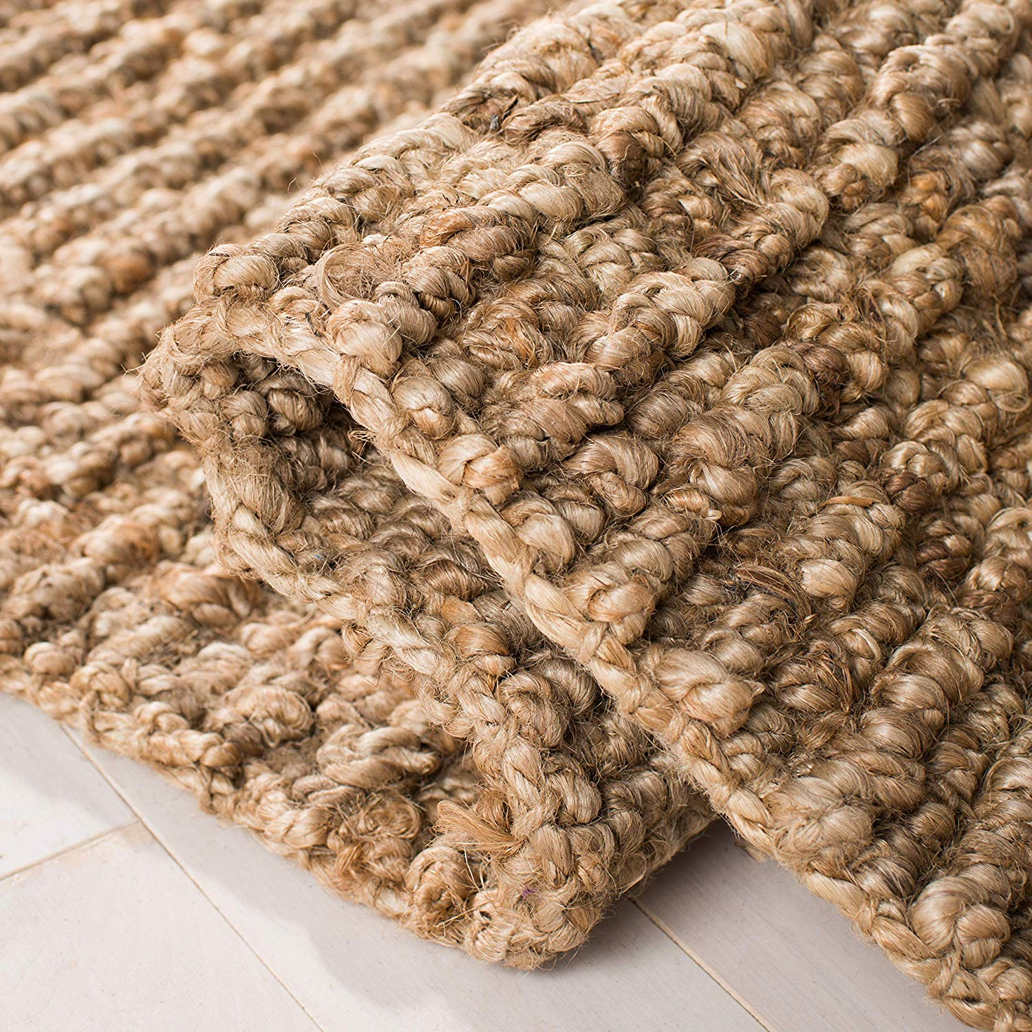 A hand-woven rugged Hemp-Rug or Sisal-Rug can help soften the floor