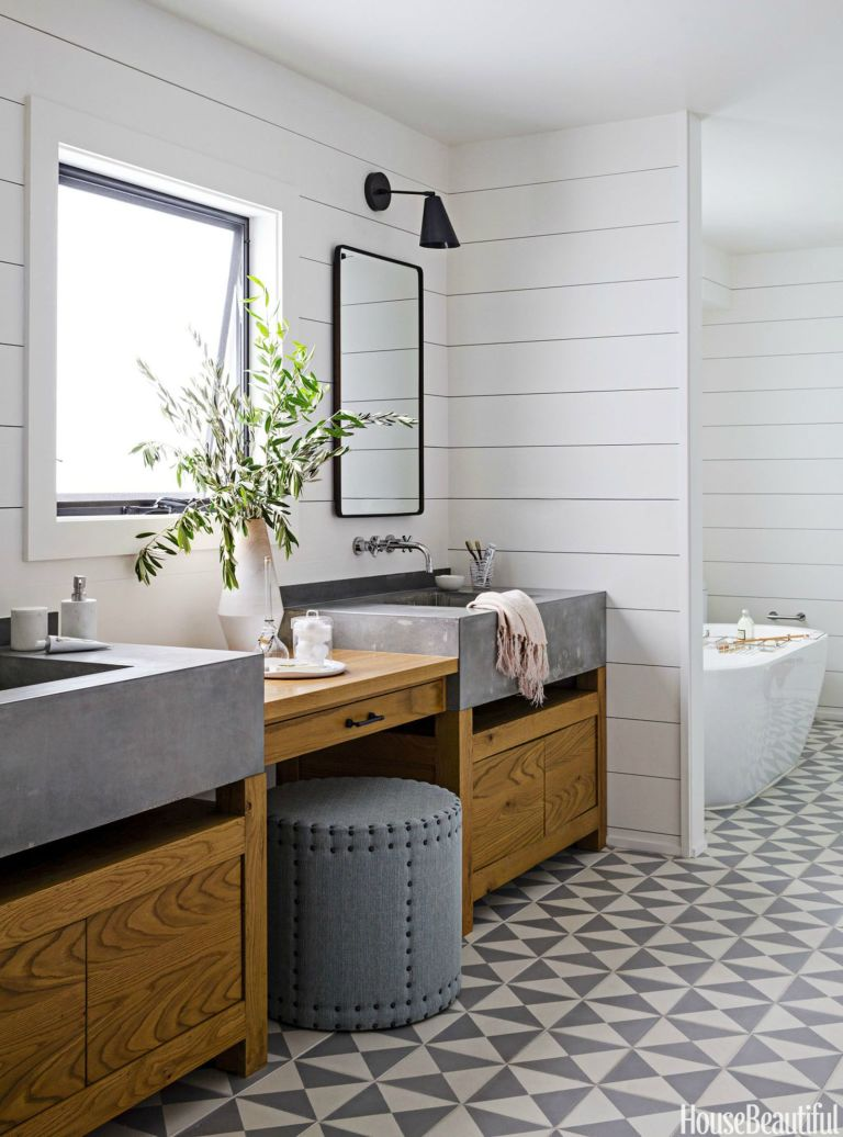 The information come together in this restroom style that has plenty of character. The grey shiplap walls enable the stunning black and white tiled flooring to star. Blended metals, antique inspired bathroom vanity, and a special faucet include the ideal touches.