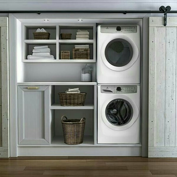 Clean and simple hide away laundry area.