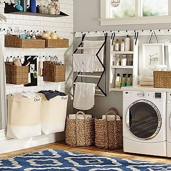 Nice farmhouse laundry room with Lots of great storage ideas