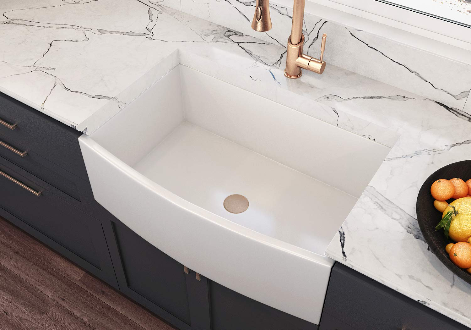 ✅AUTHENTIC FIRECLAY KITCHEN SINK: Our apron front sink, made of SPECIAL/UNIQUE WHITE CLAY found only in certain regions of the world, is solid white throughout and REPAIRABLE. Considered the best choice of undermount fireclay sink for rigorous use. Moccoa's kitchen sinks are woman-owned business. ✅STYLISH & VERSATILE: Stylish farmhouse sinks features an apron-front for easy reach and effortless style. Designs are inspired from vintage farmhouse sinks and are individually crafted by hand for a beautiful, sturdy, distinctive, clean look. Farmhouse sinks are well-suited for traditional or modern types of kitchens. ✅40% THICKER THAN Competitors: Unlike with porcelain sinks,fireclay sinks are much more DURABLE and designed for heavy use. Fireclay farmhouse sinks are capable of being fired at extremely high temperatures (over 2200° Fahrenheit). MOCCOA's fireclay sinks are SHOCK, SCRATCH, CHIP, HEAT, & STAIN RESISTANT. ✅Offers Multiple Installation Options: Fireclay sink undermount has multiple installation options - RECESSED or APRON FRONT that will enhance the style of your traditional or modern style of kitchen. ✅REVERSIBLE FIRECLAY SINK: MOCCOA's apron front farmhouse sinks offer two elegant fronts for you to choose from. One side has a decorative fluted design and the other side is straight & smooth. You can choose which side to display depending on your preference.   Price $599.00 Plus Free Shipping * Oct2019