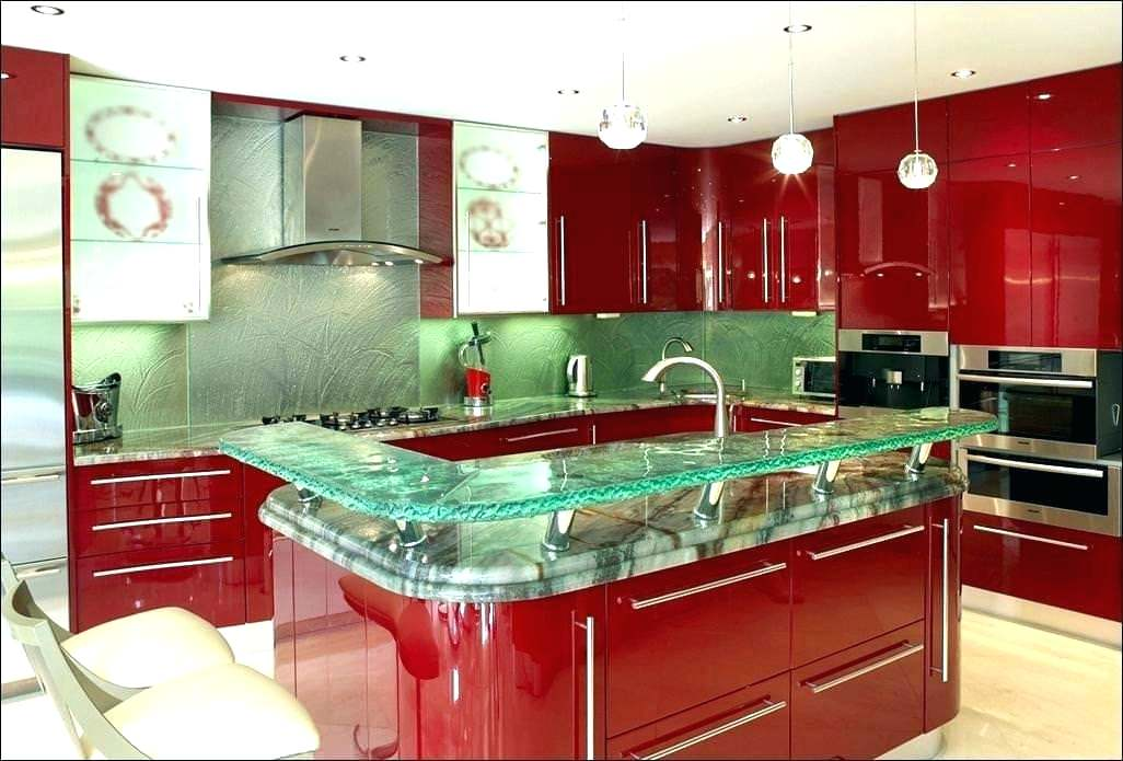 red designer kitchen with glass bar & stinless steel appliances