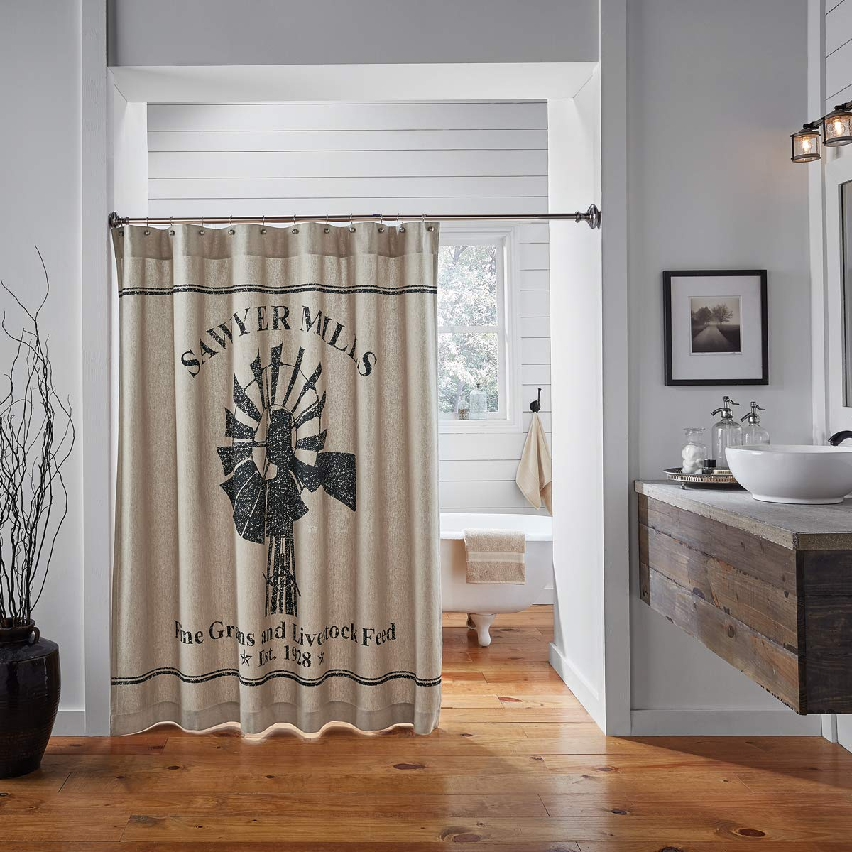 """Ashton & Willow Farmhouse Bath - Sawyer Mill Tan Farmhouse Shower Curtain, 72 x 72, Charcoal Windmill   ✯ Premium Material ✯ 100% Cotton Imported Windmill-themed black stencil in center on khaki chambray base A single grain sack stripe stenciled both above and below center motif Neat and durable hem fold Features 1.5"""" header with 1"""" button holes and 3"""" rod pocket Single fabric: Machine stitched   America's Premier Home Textile Destination  VHC Brands is a family owned business located in Branson, Missouri, but with roots in the Deep South. Founders Nancy and Billy Kline started the company as a small store in the 80's in Northwest Louisiana and grew the business to become the household name it is today through their high-quality, hand quilted, patchwork quilts.  Since the 80's, VHC Brands has experienced a move across states, overseas expansion, and the creation of many popular brands such as Lasting Impressions and Bella Taylor. After a devastating fire in October 2016, we relaunched with more vigor than ever with our April & Olive, Mayflower Market, Oak & Asher, and Season's Crest lifestyle brands – catering to farmhouse, rustic & lodge, primitive Americana, and holiday home décor styles, respectively.  Our designs and products are still rooted in classic style and crafted to bring years of enjoyment. A quilt is more than a way to cover a bed – it's a uniquely American way to decorate a room. We design every piece down to each fabric and thread color, with new products that embellish, update and maintain heritage ideas.  While we maintain a strong following in bedding, over the past two decades, VHC Brands has expanded its product offerings to include window treatment, rugs, kitchen textiles, and holiday/Christmas décor. VHC Brands is looking toward the future while continually focusing on quality, growth and an overall customer experience that has defined us since our inception. Oct.2019 Price:$32.95 Plus FREE Shipping"""