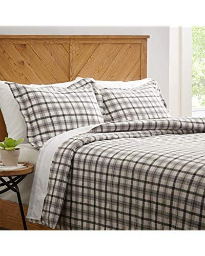 farmhouse decorating guide tip Luxurious bed linen and antiqued furnishings provide this country bedroom a homey, relaxing quality.