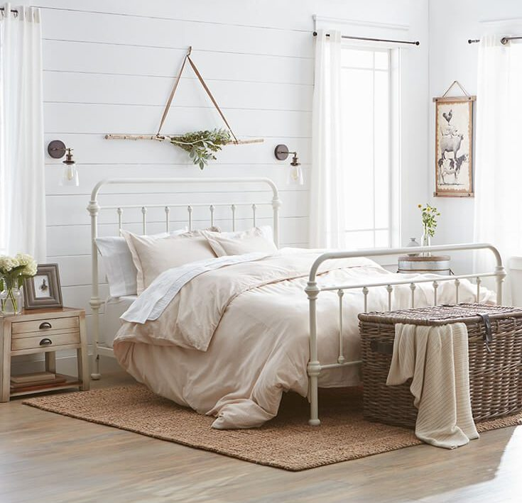 A iron bed frame coupled with some oil rubbed bronze sconces will offer simply the
