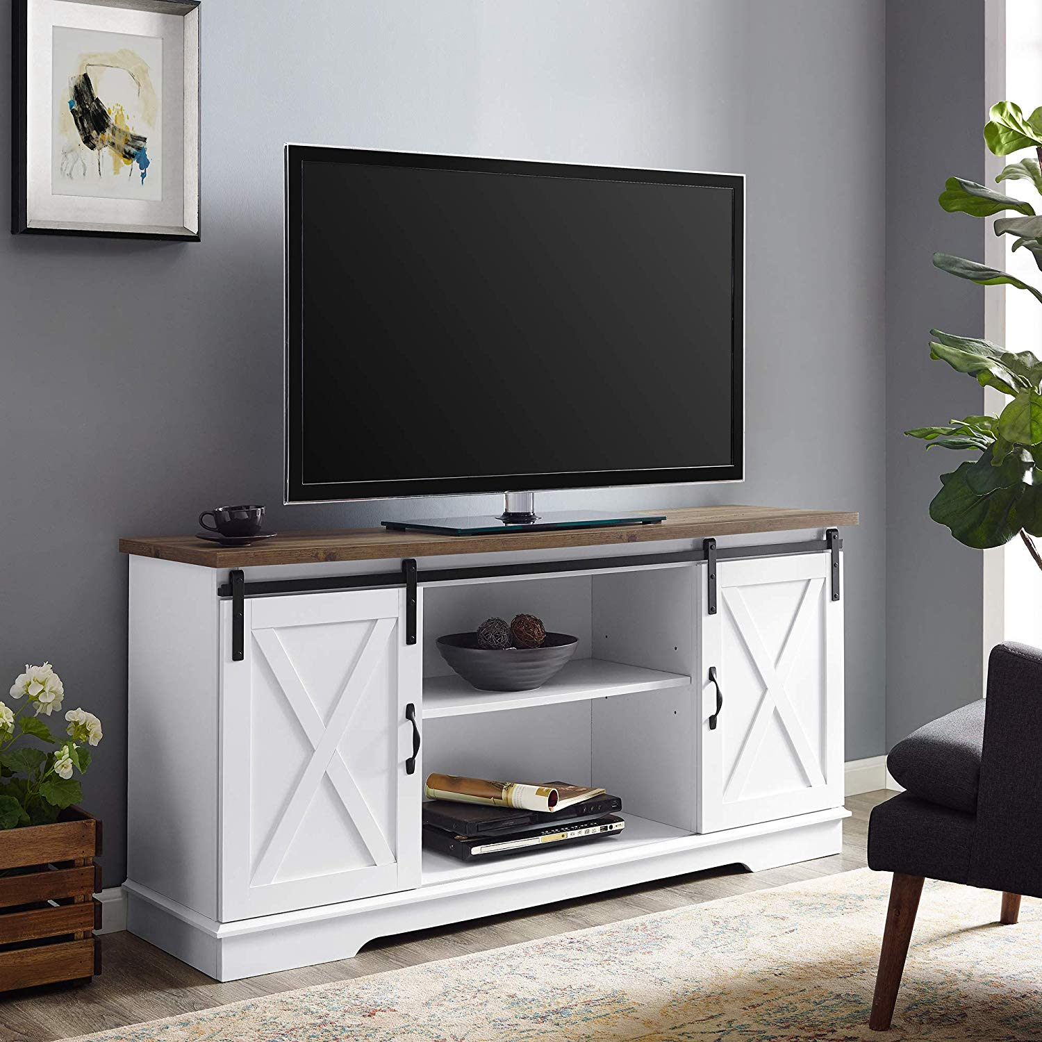 This TELEVISION stand will offer your living-room a lovely country feel, while likewise supplying lots of storage area for your electronic devices and design. Including 2 moving barn door styled cabinet fronts for a flexible style where you can either block the Middle or both sides, depending upon your requirements. Adjustable shelving and cable television management make it basic for you to keep your electronic devices in one location. This media console is built of state-of-the-art MDF. The contemporary farmhouse design of this Entertainment center will end up being a piece in your living-room you'll appreciate.