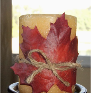 Maple Leaf Twine Wrapped Candle (source unknown) Pillar Candle (Amazon for $4) + Twine (Dollar Tree) + Maple Leaf