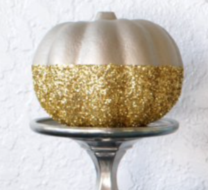 Glittery Gold Pumpkin (source unknown)  Foam Pumpkin (Dollar Tree) + Gold Glitter ($2 Walmart) + Metallic Rust-oleum Spray Paint ($5 Amazon) +  Silver Candle Holder ($2 at Goodwill)