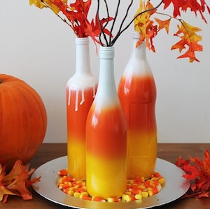 Fall Decor DYI - Candy Corn Bottle  Centerpiece from Brit + Co