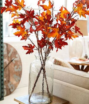 Fall Leaf Vase (source unknown)  Sticks (Free) + Maple Leaves (Dollar Tree)+ Glass Vase (Dollar Tree)