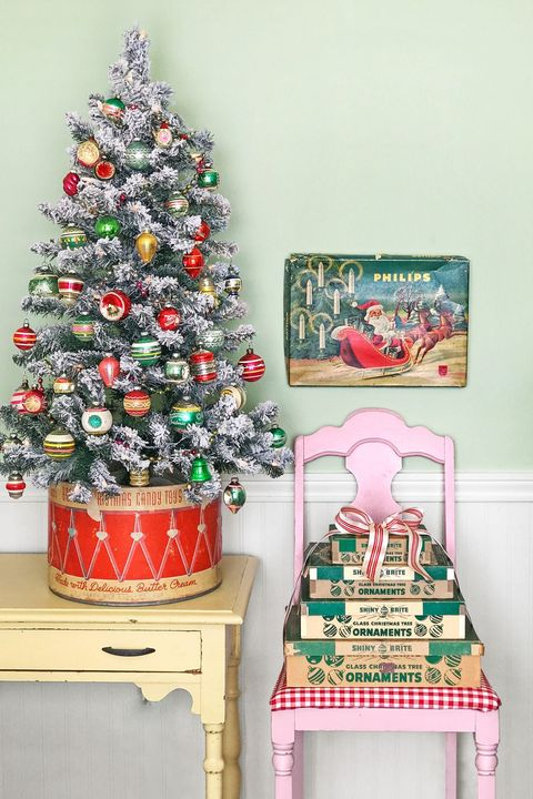 This little Christmas tree brings back memories. We kids had a tin drum like this and I love the idea of how all these antiques are grouped  Shop mini Christmas Trees