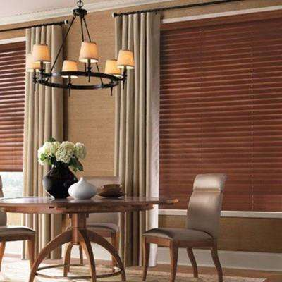Both value & premium wood blinds are made of real woods. The value wood blind louvers are made of assorted Oriental hardwoods. The premium wood blind slats are manufactured from American Basswood. Basswood is a unique cross grained wood, containing rich detail and is naturally resistant against warping.