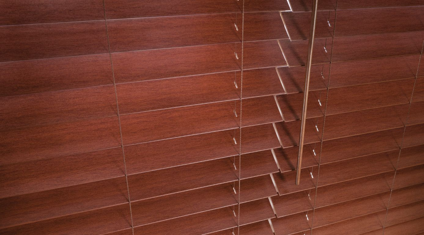 """Faux Wood Window Blinds are PVC Blinds that are made from a solid or foamed Poly Vinyl Chloride (PVC) plastic. PVC blinds have really gain popularity over the past 20 years. They are usually 2"""" to 3 Inches wide. And the blind louvers surface is smooth. However, they are also available in a very luxurious and classy looking wood grain imitation."""