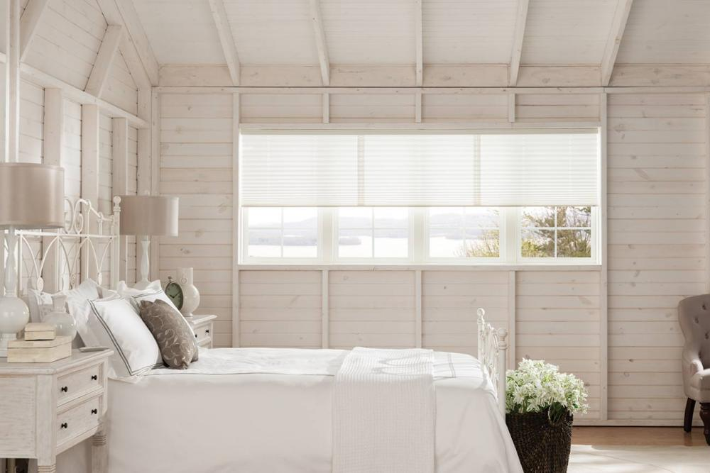 window shades and blinds - Pleated shades :These blinds contain pleated fabric shades which are usually pulled up to the top in the window.