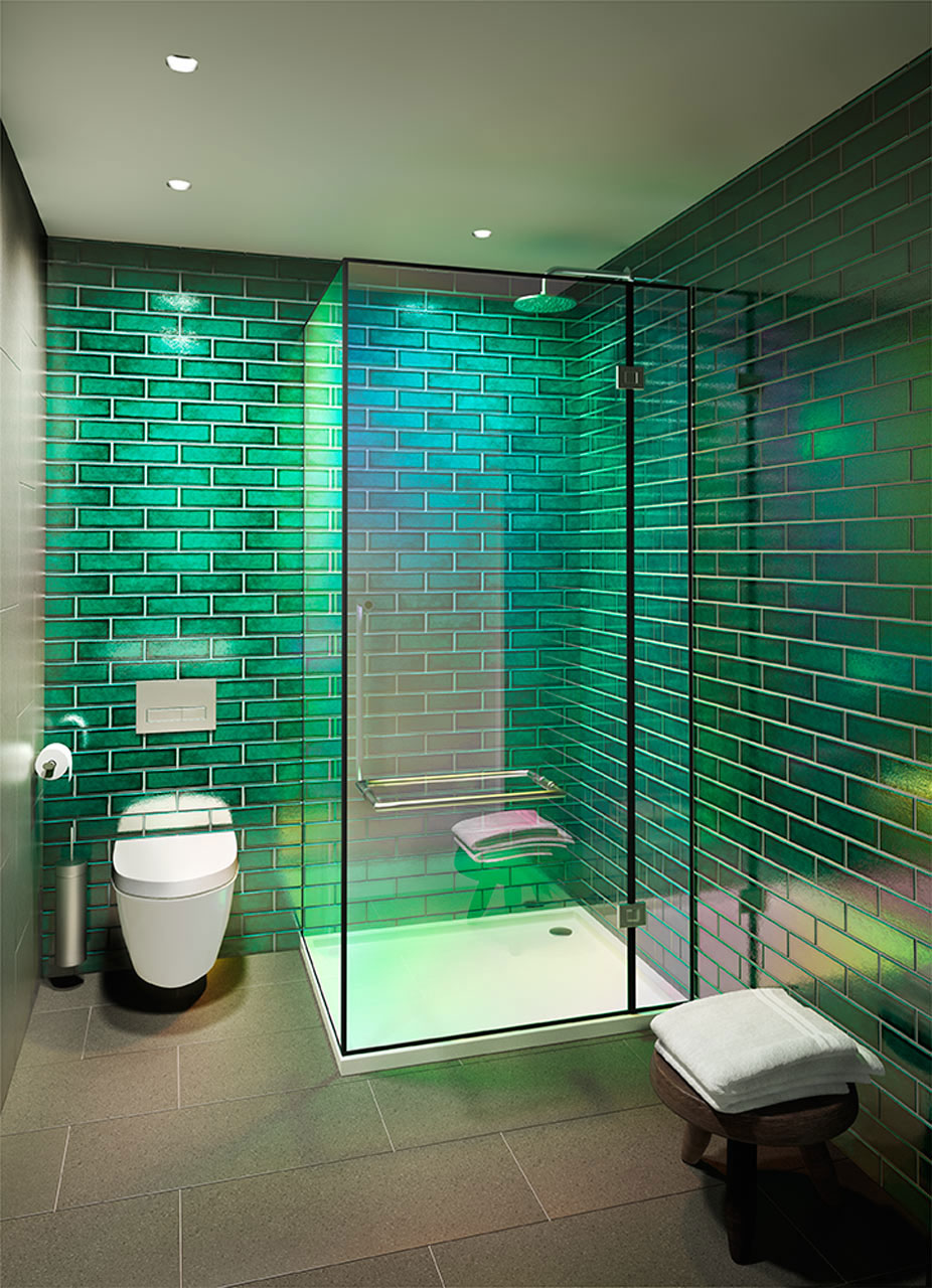 Studio apartment or condos have their own unique bathroom decorating requirements. This smooth, minimalist style takes advantage of the brickwork and big shower that control the area. This bathroom does not have any windows, so the green-glazed bricks